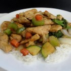 Comida China - Chicken and veggies are stir-fried with soy sauce and oyster sauce and served over white rice for an Asian-inspired meal.