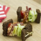 BLT on a Stick - This BLT-on-a-stick appetizer made with rye bread, bacon, lettuce, and tomato is a crowd-pleasing party food.
