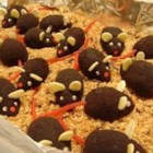 Chocolate Mice - Kids will love these, they are whimsical and fun. Cute chocolate mice rolled in confectioners' sugar or chocolate cookie crumbs are very realistic.