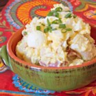 Aunt Vi's Red Skinned Potato Salad - Creamy potato salad loaded with hard-boiled eggs and green onions is a crowd-favorite at parties and potlucks.