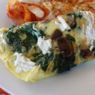 Eggs Florentine - This quick and easy recipe for eggs Florentine includes spinach, mushrooms, and cream cheese cooked with eggs and garlic for a simple breakfast.