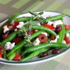 Marinated Green Beans with Olives, Tomatoes, and Feta - Just like the name of the dish implies, this recipe makes a lovely side dish of green beans, kalamata olives, and tomatoes. These items are tossed with red wine vinegar, garlic, and oregano before being finished with a sprinkling of feta cheese. Allow the flavors to marinate together overnight for even better results.