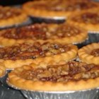 Butter Tarts - Butter, sugar, cream, raisins, and walnuts fill these traditional butter tarts.