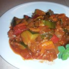 "Zucchini ""Ratatouille"" - Zucchini, onions, and bell peppers are simmered in a tomato-based sauce creating a zucchini ""ratatouille""; serve alongside polenta."