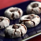 Fudgy Peanut Butter Buttons - These chocolate-peanut butter cookies are marked with your thumbprint and dark chocolate.