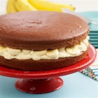 Giant Banana Cream Whoopie Pie - Make a giant whoopie pie recipe with chocolate cake layers filled with vanilla pudding and sliced bananas.