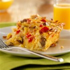 Potato, Sausage and Egg Breakfast Casserole - An easy breakfast recipe of shredded hash brown potatoes, Egg Beaters, sausage, red bell pepper and Cheddar cheese baked together.