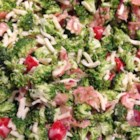 Creamy Broccoli Salad - Broccoli, bacon, and mozzarella cheese are tossed in a creamy dressing for a perfect picnic salad.