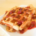 Sweet Potato Waffles with Cranberry Maple Syrup - These flavorful sweet potato waffles, topped with cranberry maple syrup, are perfect for a post-Thanksgiving or Christmas morning breakfast!