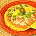 Tuna Tostadas I - An unlikely combination of tuna and refried beans, but one that is sure to be a hit! Tostada shells, covered with refried beans and topped with a zesty tuna salad, shredded lettuce, and avocado. Quick, too!