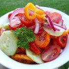 "Fire and Ice Salad - Cayenne pepper provides the ""fire"" in this salad of tomatoes, peppers and onions marinated in a cooked dressing.  Sliced cucumbers provide the ""ice"", as they are tossed into the salad just before serving."