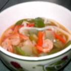 Oriental Shrimp Noodle Soup - Shrimp, snow peas, carrots, celery and rice noodles are simmered with chicken broth flavored with ginger and garlic in this quick soup.