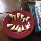 White Chocolate Bugles(R) - Bugle(R) snacks are filled with peanut butter and coated in white chocolate, creating a fun dessert in the shape of shark teeth perfect for Shark Week.
