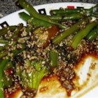 Garlicky, Spicy and Sesamey Green Beans - Always looking for a way to make green beans different, this one is such a winner. Green beans are sauteed with garlic, shallot and sesame seeds for a tasty side dish with Asian flair.