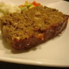 Glazed Meatloaf I - Ground beef meatloaf is made with egg, bread, and onions, then topped with a sweet and sour glaze, and baked.