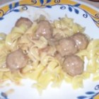 Anna's Amazing Easy Pleasy Meatballs over Buttered Noodles - My friend Anna makes the most amazing and easy meatballs with gravy! Prepared in a slow cooker, this recipe couldn't be any easier! Serve over buttery hot cooked noodles and you'll have a happy crowd! Mangia!