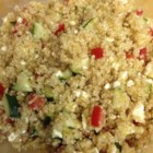 Quinoa Summer Salad with Feta - Cold quinoa keeps this summer salad with tomato, cucumber, and feta cheese light and refreshing.