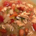 Terri's Chicken Carcass Stew - This chicken stew inspired by the flavors of Mexico combines leftover chicken meat with hominy, pinto beans and green chilies in chicken stock seasoned with oregano and chili powder.