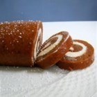 Granny Kat's Pumpkin Roll - A sweetly spicy, pumpkin-flavored cake is spread with a silky rich cream cheese filling and rolled up like a pinwheel. For easy lifting, line your baking pan with parchment paper. Chill the cake to set before slicing.