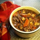 Vegan Guinness Stew - Simmer seitan, carrots, onions, and celery in Irish beer to make this rich and flavorful vegan stew that pleases vegetarians and carnivores alike!
