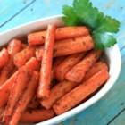 Quick and Easy Baked Carrots - Nutmeg, cinnamon, and a pinch of sugar make these baked carrots a great side dish for any meal.