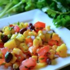 Black Bean Mango Salsa - This salsa with black beans, corn, tomatoes, bell peppers, red onion, jalapeno pepper, and mango makes a perfect summer appetizer.