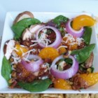 Spinach and Mandarin Orange Salad - A spinach and mandarin orange salad with bacon and slivered almonds gets a new twist with a warm homemade dressing that is sure to impress your guests.