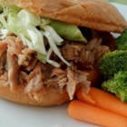 North Carolina Pulled Pork - Pork shoulder is slow cooked in a tangy, sweet homemade barbecue sauce, perfect for serving a hungry family.