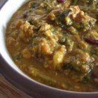 Spinach, Red Lentil, and Bean Curry - This very tasty vegetarian curry combines lentils and mixed beans with sauteed onions, fresh spinach, curry seasonings, yogurt, and tomatoes. Serve with rice or on naan.