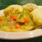 Irish Chicken and Dumplings - Here's a cozy dish to comfort on a dark and stormy night. A creamy, fragrant stew of chicken, celery, onions, carrots, peas and potatoes plays host to biscuit dough, dropped by the spoonful into the boiling hot liquid. Simmer until the dumplings are done.
