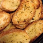 Make-Ahead Garlic Toast - Parmesan garlic butter is spread over sliced Italian bread, then quickly frozen and stored so you'll have garlic toast ready whenever you're in the mood.