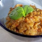 Tomato-Curry Lentil Stew - In this recipe serving two, dried lentils are cooked with garlic and stewed tomatoes in curry seasoned broth with onions and celery.