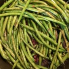 Citrus-Bacon Green Beans - Brighten up your green beans by simmering them in butter with lemon, lime, and bacon bits!