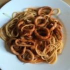 Calamari with Tomato Sauce - Tasty squid is sauteed in a garlic and tomato sauce, then served over linguine.