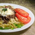 Ground Beef Mexican Style - Bell peppers, green onions, and your favorite salsa combine with beef and egg noodles for a stove-top casserole. Garnish with shredded cheese and chopped tomatoes.