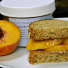 Summertime Almond Butter and Peach Sandwich - Replace jelly or jam with slices of fresh peach and almond butter for the peanut butter and you have a great summertime alternate to the classic sandwich.