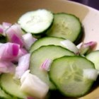 "Cucumber Salad I - Vinegar with a bit of sugar  ""pickles "" the cucumbers and red onion slices nicely. Serve as is, or spoon over grilled hamburgers or layer between two slices of cheese in a grilled cheese sandwich."