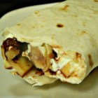 Fruit Tortilla Wrap-Up - Wrap the fruit of your choice with chocolate chips and cream cheese inside a soft tortilla to make this quick and easy snack or dessert.