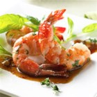 Salt Roasted Shrimp with Saffron Wine Sauce - These mouth-watering shrimp appetizers are roasted on a bed of hot salt, then drizzled with a saffron-wine sauce.