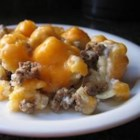 Tater Tot Bake - A lickety-split version of that ever-popular standby, shepherd's pie. Seasoned ground beef and onions are sauteed, layered in a casserole with potatoes, topped with condensed cream of mushroom soup, sprinkled with cheese and baked.