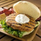 Thai Chicken Burgers - Perfect for a more exotic barbecue, these Thai-inspired chicken burgers combine ground chicken with sweet, tangy peanut sauce and red curry paste.  Barbecue or pan-cook, and serve with coconut-mint mayo on toasted rolls.