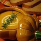 Butternut Squash Bisque - A steaming bowl of flavorful butternut squash pureed with vegetables and spices is the perfect way to warm up on a cool autumn day.