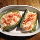 Baked Zucchini - Zucchini is parboiled, seeded and stuffed with a mixture of cream cheese, sour cream, Parmesan cheese and garlic.