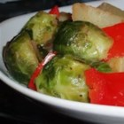 Brussels Sprouts Stir Fry - Brussels sprouts are combined with potatoes, onions, and red peppers in a stovetop medley that's ideal for Thanksgiving or any wintertime dinner.