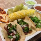 Barbacoa Meat - Barbacoa meat, also known as beef cheek meat, is slow-cooked with onion and garlic until juicy and tender. Serve on tortillas with hot sauce and cilantro.