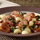 Smoked Sausage Gnocchi with Sun-Dried Tomatoes - Prepared gnocchi with smoked sausage, sun-dried tomatoes and spinach is topped with Parmesan cheese for a quick and delicious weeknight meal.