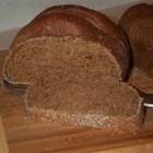 Bread Machine Pumpernickel Bread - A hearty, healthy bread that combines bread, rye, and whole wheat flours with cocoa and molasses.
