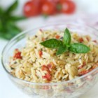 Sun-Dried Tomato Basil Orzo - Basil and sun-dried tomato add flavor and zing to this simple yet delicious pasta salad recipe. It's perfect for picnics, and great served warm or cold.