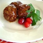 Cranberry Meatballs - Traditional ground beef meatballs are cooked in a cranberry sauce in this recipe which can be served as an entree or alongside turkey.