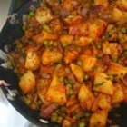 Aloo Matar - Potatoes and peas are cooked in a tomato sauce with Indian seasonings.